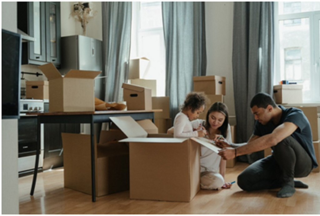 couple and child packing and preparing to move