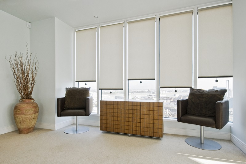 recreation room with roller blinds over the windows