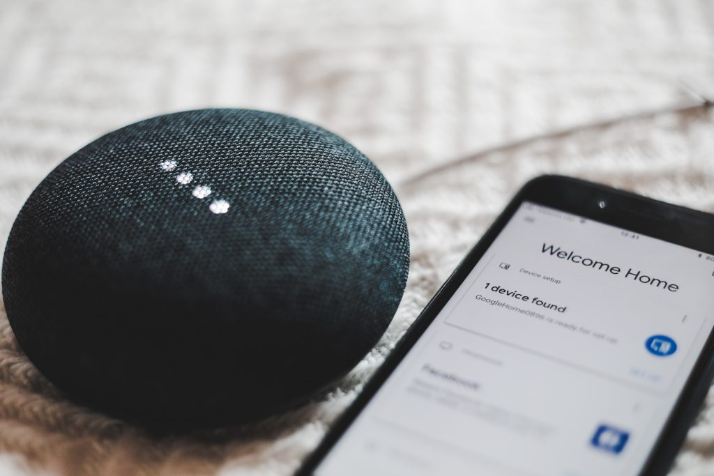 smart assistant device next to smartphone