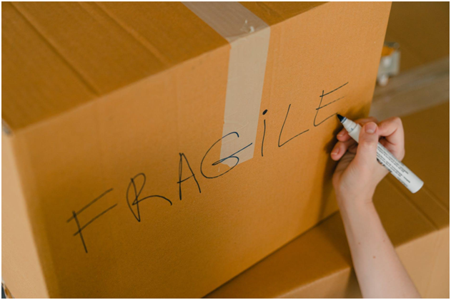 writing fragile on side of a box
